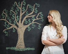 Woman with chalkboard drawing of money tree