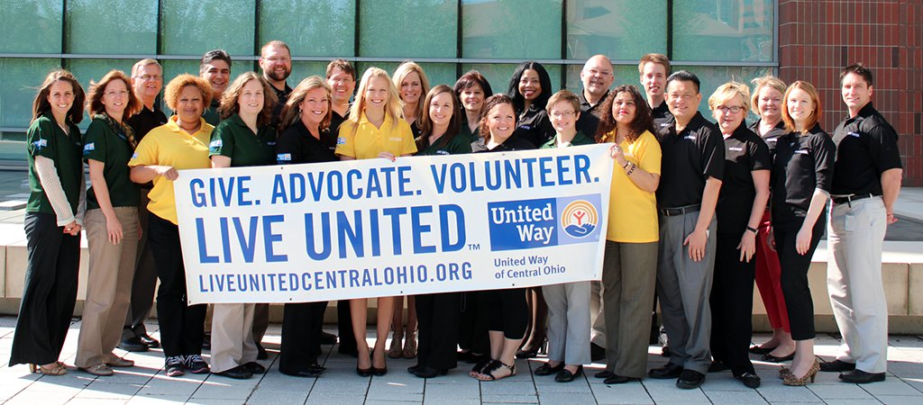 Group photo of Grange United Way volunteers holding a United Way banner reading: Give. Advocate. Volunteer.
