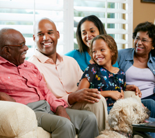 Large Grange-insured family sits together on a couch