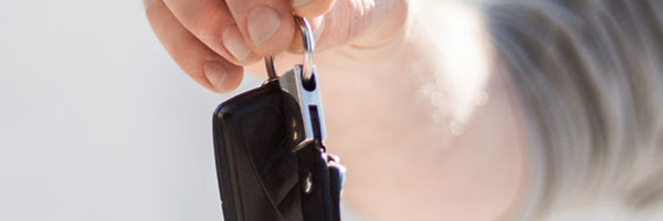 Man passes off car keys to a family member or friend