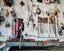 Workbench with tools hanging on the wall in a home garage