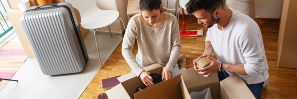 Couple unpacks boxes in new home
