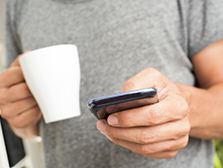 millennial man with coffee and smartphone