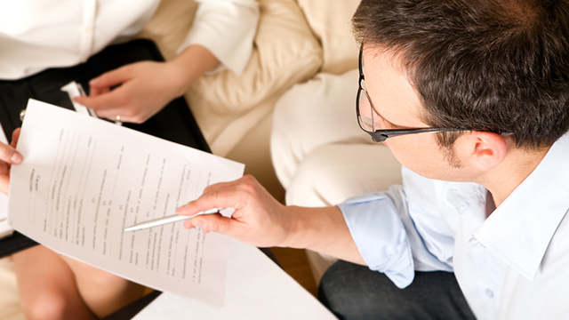 Man reviews insurance documents with agent