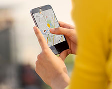 Person watches rideshare driver map on smartphone